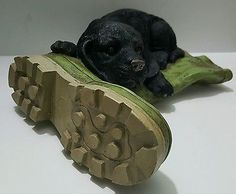 "Black Lab Puppy Dog Lying on Boot Statue Figure 10.5"" long x 8"" wide 3.5"" tall"