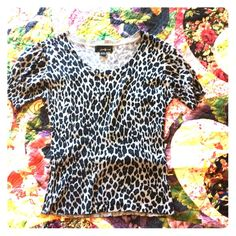 Cheetah Print Fitted Top Super comfy, super cute, cheetah print shirt. Perfect under a blazer or jacket, or alone. Forever 21 Tops Blouses