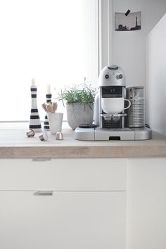 Gorgeous kitchen styling. The Gran Maestria Nespresso would be fab in my kitchen!