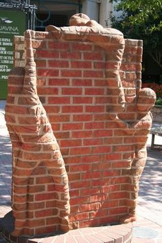 North Carolina artist Brad Spencer creates extraordinary sculptures out of bricks. His work ranges from free-standing sculptures to relief sculptures. Some of his most striking works feature figures that appear to be seamlessly part of brick walls.