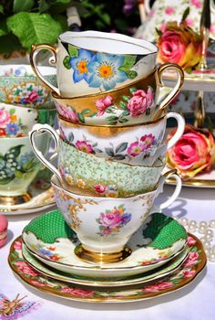 A collection of beautiful English fine bone china antique and vintage tea trios, vintage teacups and saucers and tea plates.