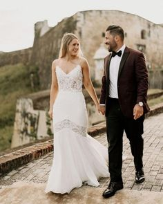 """Spaghetti strap lace bodice wedding dress with illusion details. Jackie & Josean's destination wedding in Puerto Rico. """"In order to enhance the surroundings of El Convento, we styled our reception space with a modern pop,"""" said @jackieafernandez. 💥 """"My @pninatornai dress tied into our theme perfectly. The beaded detailing was so intricate and perfectly crafted, while from a distance, also had an effortless to it."""" Pnina Tornai dress available at #Kleinfeld Pnina Tornai Dresses, Wedding In Puerto Rico, Lace Wedding, Wedding Dresses, Lace Bodice, Tie Dress, Fit And Flare, Illusion, Distance"""