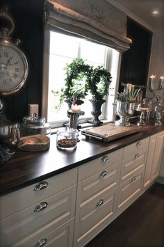 Vila Paprika- black walls, white cabinets, butcher block counters, chrome chrome chrome