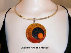 collier fantaisie en orange dégradé et noir  en fimo