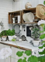 Could I make open shelves like this for my kitchen with wood crates and then put decorative shelf brackets under them?  Im dying: this is a good idea. white tile + loads of plants