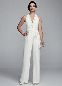 Halter crepe jumpsuit features a lace trim deep v-neckline with lace back. Removable sash at waist.