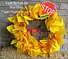 Paper Napkin Wreath. for only $3.00 . looks neat and easy. love the pop of color for a door. I won't do the school bus, but would use yellow for summer, orange for fall, blue for winter, red for valentines.etc