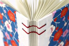 https://flic.kr/p/ayp9yV | Hand-stitched Plum Blossom Journal Yuzen is a type of handmade paper that is silk-screened with many layers of ink. I edged the book with a lovely textured handmade paper that shows off the red waxed linen thread I used to stitch the book.