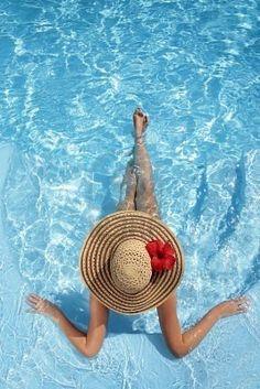 Ocean relaxing time in a great beach hat