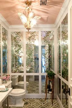 Gorgeous mirrored powder room  Ruthie Sommers