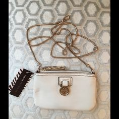 🛍 Dana Buchman White Leather Cross Body Bag Gold hardware.  Zip closure.   3 back card slots and 2 interior pockets.  Measures: 6x4x26. Dana Buchman Bags Crossbody Bags