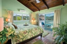 The Hibiscus Suite contains a stately mahogany king bed with matching nightstands.  Each night stand has a lamp for reading, telephone and ceiling fan.  This suite is air conditioned with a full bath just outside containing a large shower and full size sink/vanity.