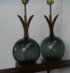 Gorgeous pair of mid century Danish Modern teak wood and glass lamps.    Large smoke gray slightly ribbed glass balls on teak block bases, with