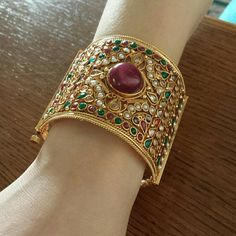 Indian cuff bracelet Gorgeous gold bracelet with semi precious stones and pearls. Opens and closes with a screw . Width is two and half inches Jewelry Bracelets