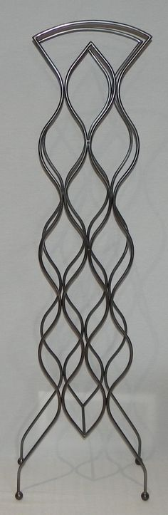 The DECO wrought iron wine rack design holds twelve bottles of your favorite wine and is designed to fit nicely into a corner or along a feature wall of your home.