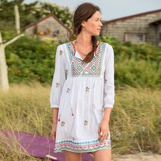 """ACOUSTIC SOUL TUNIC--An updated look for an ancient art, our flowing tunic is the perfect canvas for skillfully rendered, cross-stich embroidery. Button cuffs. Cotton. Machine wash. Imported. Exclusive. Sizes XS (2), S (4 to 6), M (8 to 10), L (12 to 14), XL (16). Approx. 34""""L."""
