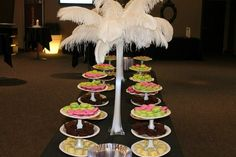Feather table arrangements with trays made from dollar store items. - Gateway Church Pink