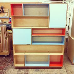 Maple plywood bookshelf with color laminate. We love it. Made by Kerf Design kerfdesign.com