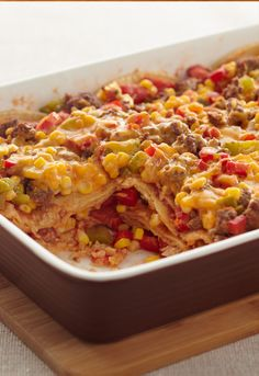 Layered Fiesta Casserole —Say Hola! to your new favorite Mexican-inspired casserole. It's layered with ground beef, salsa, tortillas and melted cheddar cheese.