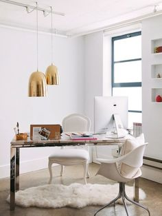 Love the juxtaposition of the sleek chrome desk legs with the petrified wood top