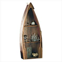 "Wood Rowboat Curio Cabinet #31182 $32.15 This hand-crafted rowboat and oars with antique-style finish can serve many purposes, from display piece to magazine rack to a wall shelf for miniatures. 24 7/8"" x 9 3/4"" x 3 5/8"" thick."