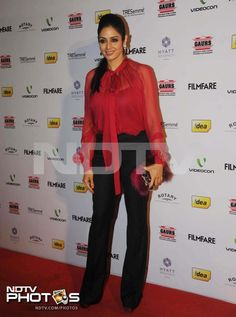 Sridevi represented the veterans and was lovely in red silk shirt and black pants