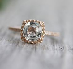 Cushion cut white sapphire in rose gold with diamond pave.