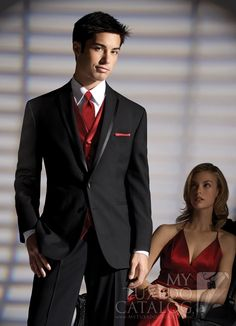 Perfect suit. Black suit, white shirt, red vest, tie, and pocket lining.