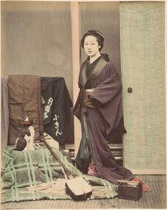 Shinichi Suzuki, [Japanese Woman in Traditional Dress Posing with Cat and Instrument], ca. 1870s. Gilman Collection, The Metropolitan Museum of Art.
