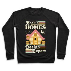 """Nook's Homes Design Expert - Show your love of video games and interior design with this cute happy home inspired design. This cute gamer shirt features an illustration of a house and the phrase """"Nook's Homes. Design Expert."""" Show that you know how to choose furniture for an anthropomorphic animal like a pro with this cute shirt."""