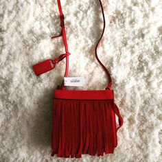 "HP 12-21 Kate Spade Saturday fringe crossbody HOST PICK 12-21 - FRESH FASHION  condition: new with tags retail: $140 plus tax details:  - Kate Spade Saturday brand: very rare and hard to find, completely sold out! Price tag in Japanese yen-won't find this anywhere else! - red suede fringe on both sides, red leather body and adjustable strap - dust bag - hanging tag - cotton interior - 6.5"" x 6"" x 2.5"", strap up to 46.5""   reasonable offers welcome-please use offer link! bundle to save more…"