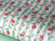 floral & white and green striped fabric