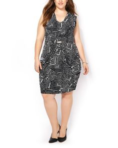 Take your look to next levels in this gorgeous plus-size dress boasting a unique monochrome print! It features a draped front brought together at front with a metallic piece, side pockets and a flattering fit. Accessorize it with stylish jewelry for a night out!