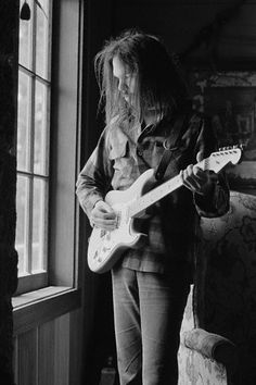 1973 | Neil Young home on the ranch, playing his Strat. | Image by Henry Diltz