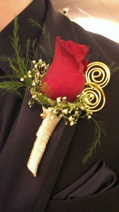 classic red rose boutineer with babies breath fern and gold wire swirls