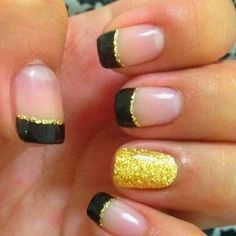 Black with gold glitter outlines and accent nail