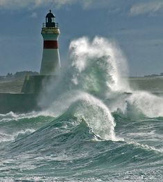The North Sea crashing around the harbour lighthouse at Fraserburgh, which lies at the extreme northeast corner of Aberdeenshire, Scotland. Lighthouse Pictures, Beacon Of Light, Am Meer, Ocean Waves, Big Waves, Strand, Seaside, Coastal, Beautiful Places