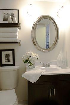 Chic small bathroom design with oval silver beaded mirror, espresso modern bathroom vanity & shelves {IKEA EKBY BJÄRNUM shelves & brackets} Bad Inspiration, Bathroom Inspiration, Bathroom Ideas, Bath Ideas, Bathroom Interior, Bathroom Renovations, Bathroom Layout, Bathroom Updates, Bathroom Colors