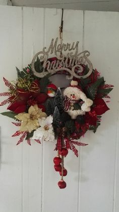 Christmas wreath I made for a friend , lots of bells, flowers and sparkle