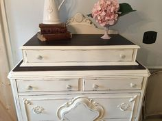 Vintage dresser refinished in Annie Sloan chalk paint color of Old white with dark stain on top of dresser