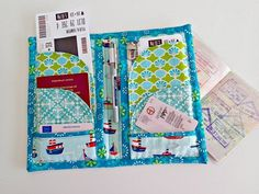 Sewing pattern for a family travel and passport wallet pattern. Hold all your passports, tickets and travel documents with a pen and keys too. PDF pattern.