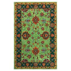 Anchor your living room seating group or define space in the den with this hand-tufted wool rug, featuring a bright Persian-inspired motif for eye-catching a...