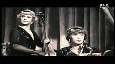 Tony Curtis and Jack Lemmon - PLAY TWO CHICAGO JAZZ MUSICIANS ON THE RUN FROM THE MOB ( ALL DOLLED-UP) DECIDE TO JOIN AN ALL FEMALE TRAVELING JAZZ ENSEMBLE BUT CAN THEY GET AWAY WITH THEIR DISGUISE COVER FOR LONG?
