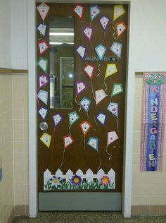 Decorated the classroom door for Spring.used different styles of ribbon for the kite tails. by magdalena Kindergarten Door, Preschool Door, Preschool Classroom, Classroom Organisation, Classroom Displays, Organization, Giraffe Room, School Doors, Spring School