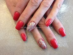 Acrylic nails with gel polish and glitter dust