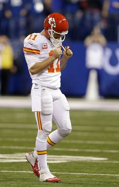 Kansas City Chiefs' Alex Smith (11) reacts after getting sacked and fumbling the ball against the Indianapolis Colts during the second half of an NFL wild-card playoff football game Saturday, Jan. 4, 2014, in Indianapolis. (AP Photo/Michael Conroy)