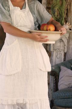 My mother always wore an apron.  She would never allow her picture taken with it on. white cotton and pockets