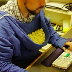 Turn your hoodie around, & Boom. You now have a popcorn holder. HILARIOUS.