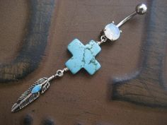 Western Cross Belly Button Ring Turquoise Feather by Azeetadesigns. $14.00, via Etsy.