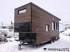 A modern tiny house on wheels in Quebec, Canada. Designed, built and shared by Minimaliste.
